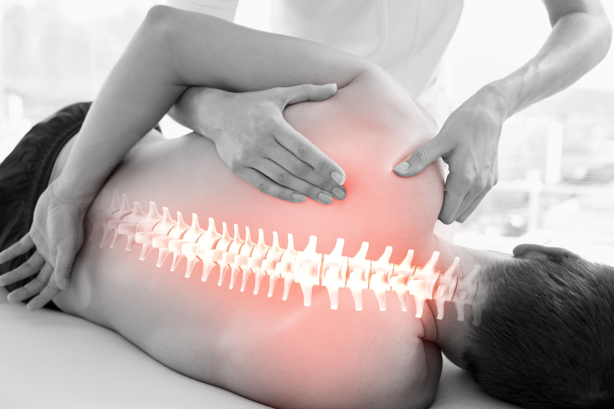 42112199 - Digital Composite Of Highlighted Spine Of Man At Physiotherapy